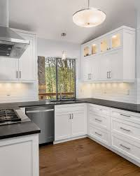 black kitchen countertops with white cabinets white cabinets with black countertops houzz