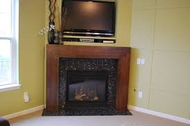 Corner Gas Fireplace With Tv Above by Modern Fireplace Remodel