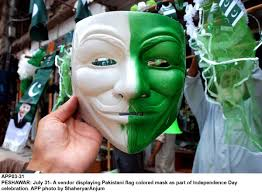 Photo Editor Pakistan Flag A Vendor Displaying Pakistani Flag Colored Mask As Part Of