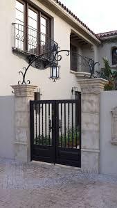 Small Spanish Style Homes A Classic And Custom Wrought Iron Entry Gate Complimented By An