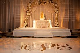 wedding arches orlando fl ivory draping gold arch with fresh flowers stage and