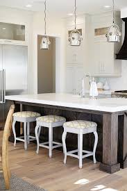 reclaimed kitchen island with industrial pendants contemporary