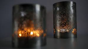 two ornamental lanterns with burning candles festive glittering