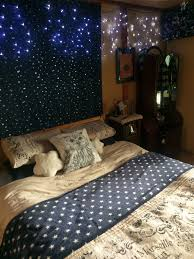 ravenclaw bedroom plenty of stars fairy lights a wand on the