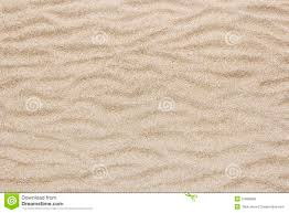 yellow sea beach sand wave for texture and background royalty free