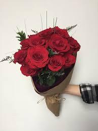 a dozen roses a dozen roses wrapped ithaca flower shop