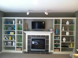 built in fireplace living room shelves with white wooden plus