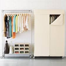 Bakers Rack With Wheels Intermetro Clothes Rack With Cotton Canvas Cover The Container Store