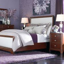 light purple accent wall purple and black furniture purple blue and white bedroom purple
