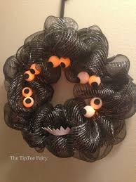 diy halloween monster eyes wreath the tiptoe fairy