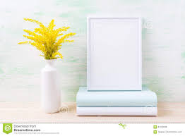 white frame mockup with ornamental golden grass and books stock