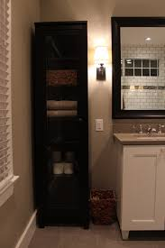 Linen Cabinet With Hamper by Bathroom White Wooden Corner Linen Cabinet With 3 Shelves For
