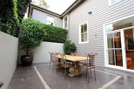 courtyard house painted in dulux crust with antique white usa