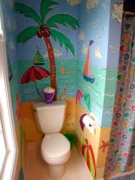 beach themed mural painted in a kids bathroom bright colors bring