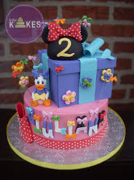 minnie mouse and daisy duck bowtique cake bottom cake iced in minnie mouse and daisy duck bowtique cake bottom cake iced in buttercream and decorated with marshmallow