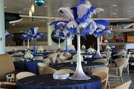 tall blue and white feather centerpieces for a masquerade themed