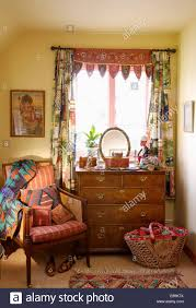 indian mirrored fabric and patchwork curtains on window above