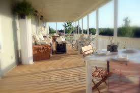 how to build a wrap around porch back porch living and an antique trunk cedar hill farmhouse