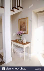 Painted Console Table Picture On Wall Above White Painted Console Table And Wicker