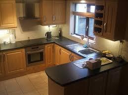 peninsula brown wooden kitchen cabinets u shaped kitchen wood