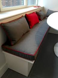 three inch grey banquette bench cushion with red trim and matching