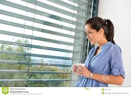 young woman day dreaming looking window blinds stock image image