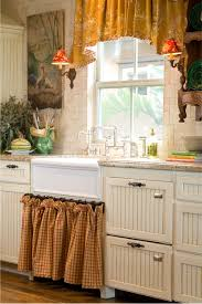 a french provence kitchen with a franke farmhouse sink and two