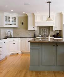green kitchen cabinets with white island two tone kitchen cabinets to inspire your next redesign