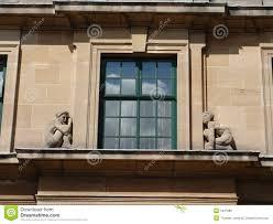 stone figures on art deco window royalty free stock images image