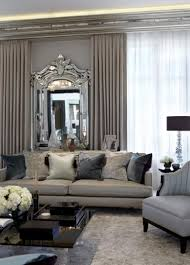 living room with modern furniture and venetian mirror elegant
