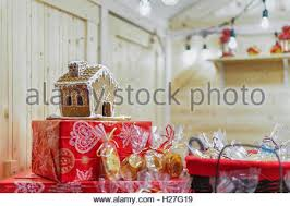 gingerbread house among other cookies on vilnius christmas market