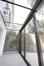 case study eton villas slim frame sliding glass doors minimal