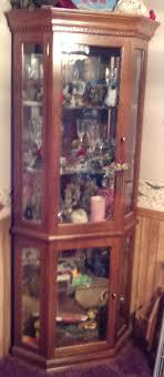 ashley furniture corner curio cabinet ashley furniture garage sale corner curio cabinet in for 5 shelf
