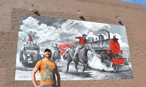 tucson s dine in movie theater roadhouse is adding more seating roadhouse cinemas collaborated with local mural artist joe pagac to paint a mural that pays tribute to movie portrayals of the old west