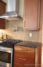 a beautiful wood and granite kitchen design backsplash black