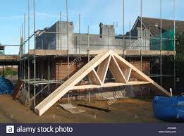 prefabricated roof trusses house building prefabricated timber roof trusses leaning against