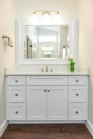 White Towel Cabinet Vanity With Grey Marble Top And Rectangular Sink On Bathroom
