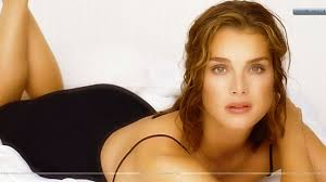 brooke shields laying on bed black dress wallpaper