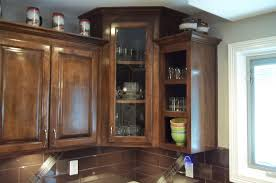 glass door corner cabinet with decoration brown polished mshogany