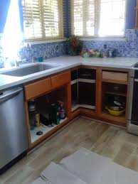 reloved rubbish pure white chalk paintA kitchen cabinets the cabinets before was outdated and did not look right with pretty light countertops bright blue backsplash after little chalk paintA