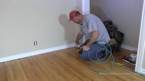 Youtube Laminate Flooring Installation How To Install Baseboard Youtube