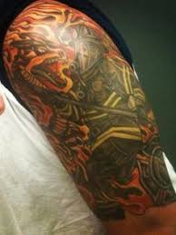 firefighter maltese cross tribal tattoo arm shared by lion