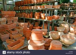 display of terracotta pots for sale in garden center stock photo