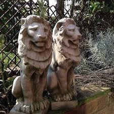 pair garden statues ornaments gate post tops finials view