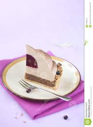 piece of chestnut and blackcurrant entremet cake stock photo