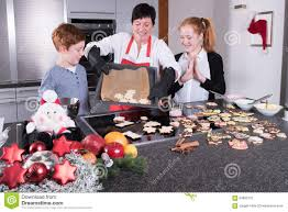 family baking christmas cookies in kitchen stock photo image