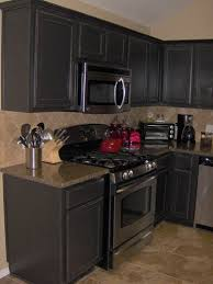 Antique Black Kitchen Cabinets Antique Distressed Black Cabinets I Want To Paint Our Cabinets So