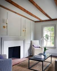 fireplace mantel surrounded by panel walls millwork paint