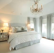 inspiration for our bedroom bedrooms oly studio elisabeth bedside table blue gray headboard blue silk damask pillows gray velvet bolster pillows glass