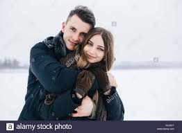 guy hugging his girlfriend from behind stock photo royalty free